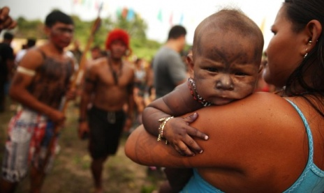 """A young child wears traditional face paint during a """"Caravan of Resistance'"""" protest. Photograph: Mario Tama/Getty Images"""