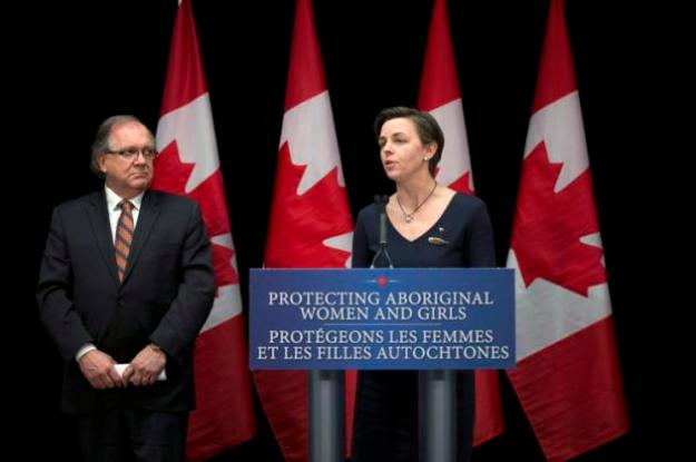 The Canadian Press - Minister of Aboriginal Affairs and Northern Development Bernard Valcourt (left) and Minister of Status of Women Kellie Leitch speak to reporters at a separate press conference following the National Roundtable for Missing and Murdered Indigenous Women and Girls in Ottawa on Friday, Feb. 27, 2015. THE CANADIAN PRESS/Justin Tang