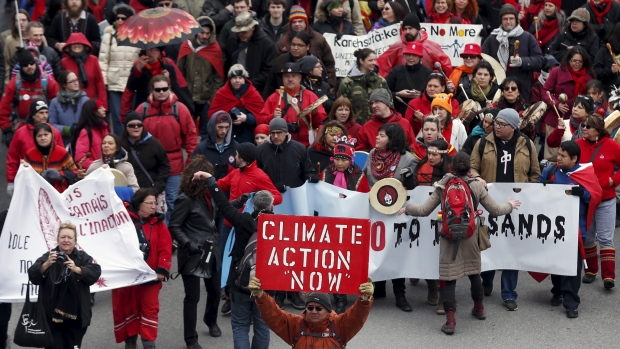 A climate-change march drew about 25,000 people to the streets of Quebec City on April 11, 2015, as protesters try to encourage premiers to take a tougher stance on climate and pipeline regulations. (Mathieu Belanger/Reuters)