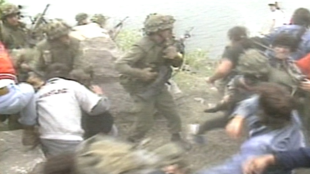 (Mohawks from Kahnawake battle with Canadian soldiers during the 1990 Oka crisis. File/photo)