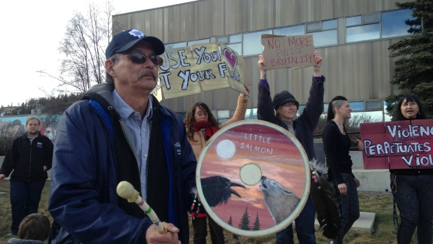 More than 50 protesters, many of them Little Salmon Carmacks First Nation members, gathered outside Whitehorse RCMP headquarters on Friday. (Cheryl Kawaja/CBC)