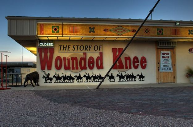 Wounded Knee Museum wall at the Pine Ridge Indian Reservation Wkmwiki/Wikimedia Commons