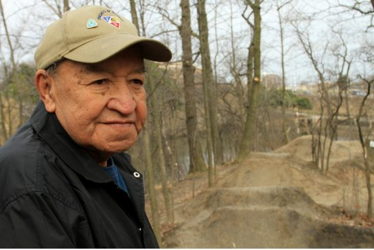 Chief Arnie General stands on what many believe are ancient Iroquian burial grounds in High Park. | Toronto Star
