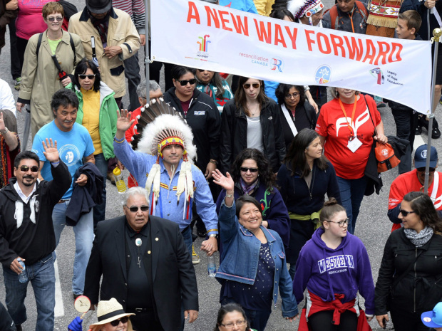 Assembly of First Nations Chief Perry Bellegarde (in headdress) and Justice Murray Sinclair (in black suit), TRC commissioner, march during the Walk for Reconciliation, part of the closing events of the Truth and Reconciliation Commission on Sunday, May 31, 2015 in Gatineau, Que. Beginning in the 1870s, over 150,000 First Nations, Metis and Inuit children were required to attend government-funded, church-run residential schools in an attempt to assimilate them into Canadian society; the last school closed in 1996. Students were prohibited from speaking their own languages, practicing their culture and often experienced physical and sexual abuse. THE CANADIAN PRESS/Justin Tang