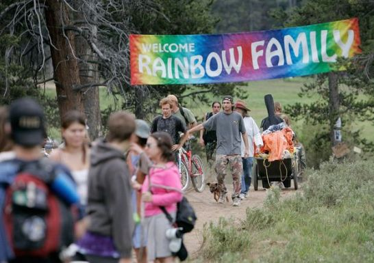 Rainbow Family members arrive in the Routt National Forest north of Steamboat Springs, Colo., in 2006, when the event drew about 20,000 people. Officials say the group may come to the Black Hills this summer.