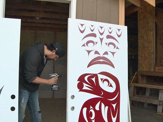More than a dozen Native American pre-apprentice students studying construction hope the tiny houses they've built will help homeless people get back on their feet. (Photo: KING)
