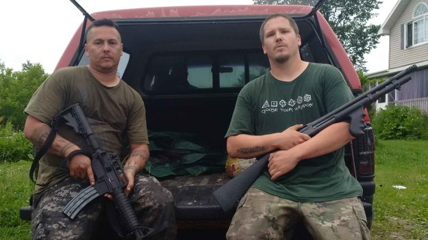 (Jerry Jock, left, and Bryan King, right, take a break after searching through swamp and thick bush for escaped murderer David Sweat. APTN/Photo)