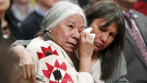 Residential School survivor Lorna Standingready, left, is comforted during the Truth and Reconciliation Commission of Canada closing ceremony in Ottawa last week. | Photo: Reuters