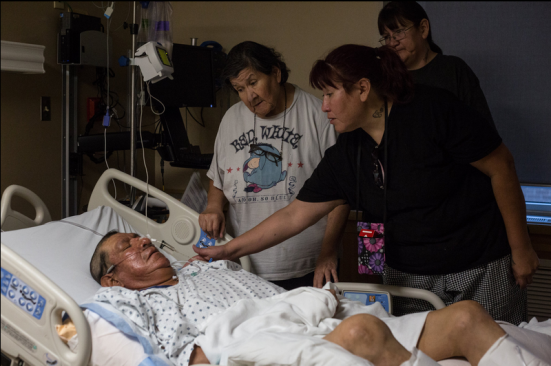 Angeline Vargas, right, comforted her brother James Goggles at a hospital in Casper, Wyo., last week. Mr. Goggles was shot at an alcohol detox facility in Riverton, Wyo. CreditRyan Dorgan for The New York Times
