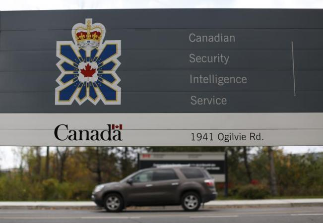 Leaked documents from the hacker group Anonymous appeared to reveal the breadth and scope of the Canadian Security Intelligence Service (CSIS) surveillance network. In this photo, a vehicle passes a sign outside the CSIS headquarters in Ottawa November 5, 2014. Reuters/Chris Wattie
