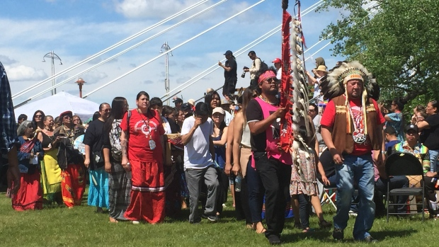 Grand Chief Derek Nepinak of the Assembly of Manitoba Chiefs walks with people at a rally for families of missing and murdered indigenous women in June. (Courtney Rutherford/CBC)