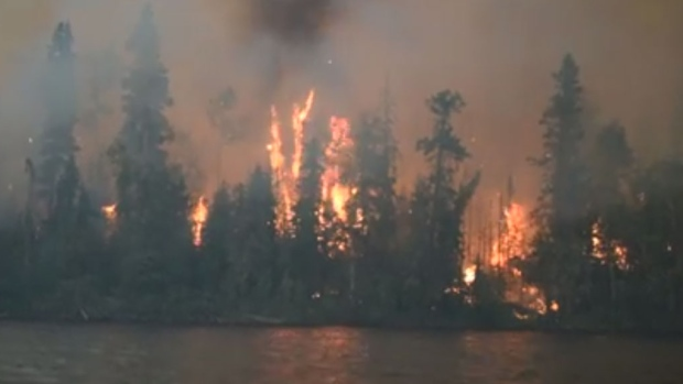 A wildfire burns on the edges of Lac La Ronge, in northern Saskatchewan. (Kandis Riese/Facebook)