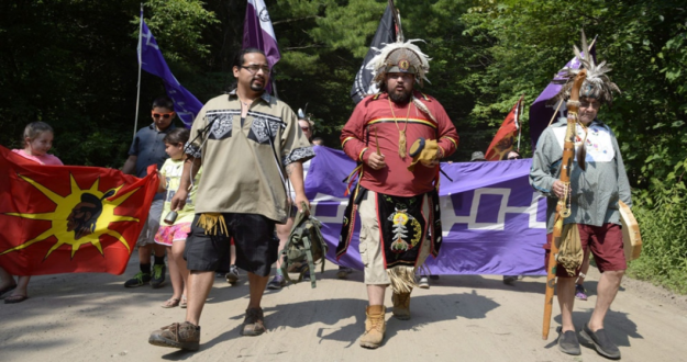 Mohawks from Kanesatake, Que., march to mark the 25th anniversary of the Oka Crisis, in Oka, Que., on Saturday, July 11, 2015. THE CANADIAN PRESS/Ryan Remiorz