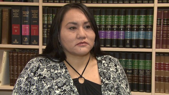 (Ethel Pelly sitting at her lawyer's office after settlement was reached. Photo: Larissa Burnouf/APTN)