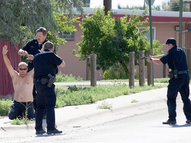 Roy Clyde is taken into custody half a block from the shooting.