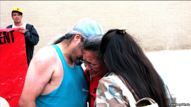 Lynn Eagle Feather, mother of police shooting victim Paul Castaway, is consoled by friends at rally in Denver, Co., July 12, 2015. (Courtesy/Steve Stalzle