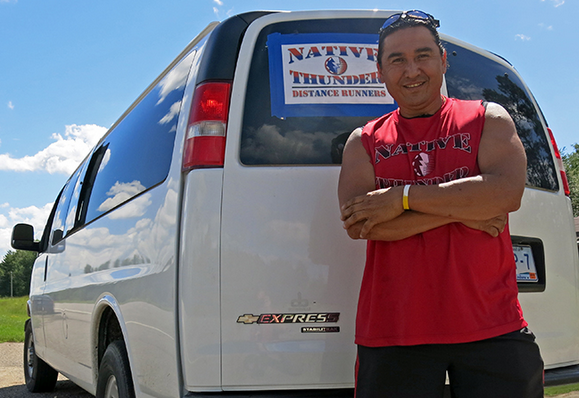 """Spirit Run coordinator and former Red Lake Chairman Floyd """"Buck"""" Jourdain drove the support bus Wednesday. Runners crow-hop the 200 mile route, with two or three running while the rest ride in cars. John Enger 