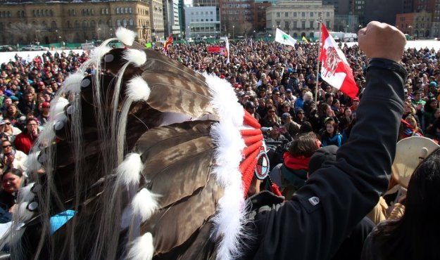 Hundreds of supporters gather on Parliament Hill, in support of a group of young aboriginal people who traveled 1,600 km on foot from the James Bay Cree community of Whapmagoostui, Quebec on Parliament Hill in Ottawa, Monday March 25, 2013.THE CANADIAN PRESS/ Fred Chartrand