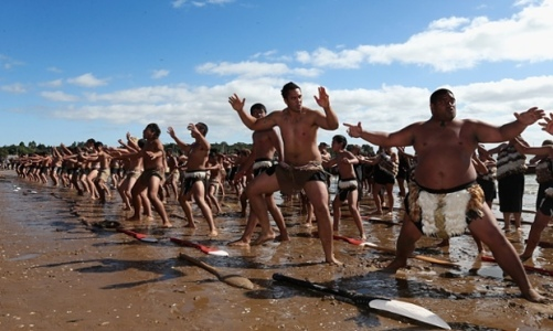 Hundreds of Waka Ama crew perform the haka on the beach to celebrate Waitangi Day in Waitangi, New Zealand. Photograph: Sandra Mu/Getty Images