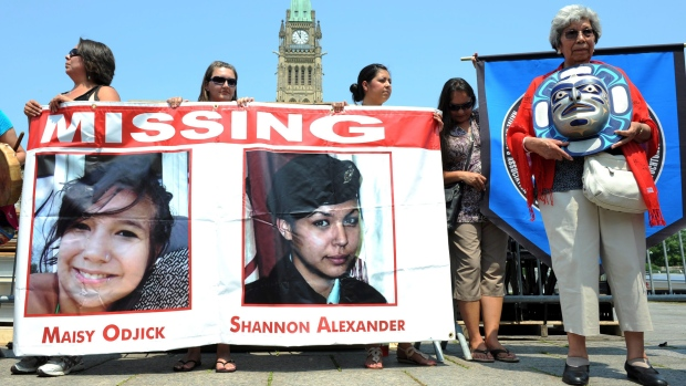 A 2011 rally on Parliament Hill in solidarity with missing and murdered aboriginal women. An internal report obtained under the Access to Information Act says a promised RCMP database to help solve the problem is long overdue and overbudget. (Sean Kilpatrick/The Canadian Press)