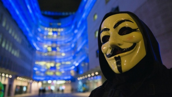 A supporter of the activist group Anonymous wears a mask during a protest against the BBC outside their studios in central London December 23, 2014. (Neil Hall/Reuters)