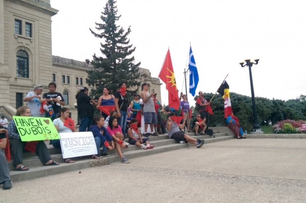 Participants in the Sask. Walk for Missing and Murdered Persons walk on the steps of the kegislative building.