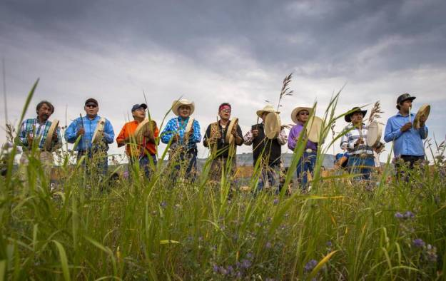 Drummers from Doig River First Nation drum on the Bear Flats near Fort St. John. Native people and archaeologists are concerned BC Hydro's Site C dam project will flood the Peace River Valley, which holds centuries-old graves and trading artifacts. (John Lehmann/The Globe and Mail)