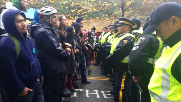 Protesters and police in a stand-off on Burnaby Mountain. CP file photo