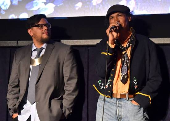 "Writer-director Sterlin Harjo (left) and actor Rod Rondeaux (right) discuss their film ""Mekko"" at this year's Los Angeles Film Festival. Source: Alberto E. Rodriguez/Getty Images"