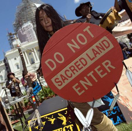 An Apache activist protests the government land swap of Arizona holy land Oak Flat in front of the U.S. Capitol. Source: Molly Riley/AP