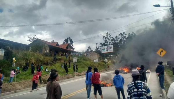 """Protesters burn tires on a road to impede traffic, police who arrived to clear the roadblock were met with violence, Loja, Ecuador, Aug. 18, 2015. 