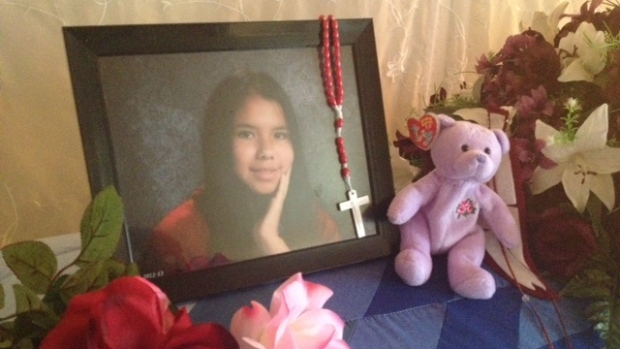 A photo of slain teen Tina Fontaine sits atop her casket in a family home on Sagkeeng First Nation last summer. (Jillian Taylor/CBC)