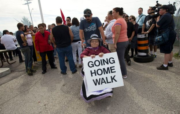 Barbara George, 83, is wheeled into the former military base at Camp Ipperwash as members of the Kettle and Stony Point First Nation celebrate the ratification of a deal that returns expropriated land to the band in Ipperwash, Ont. on Sunday September 20, 2015. Craig Glover/The London Free Press/Postmedia Network