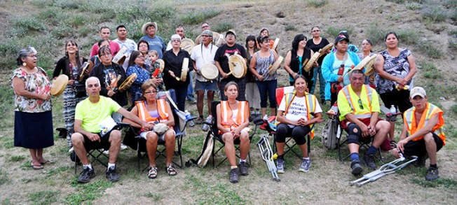 Six walkers and two pilot cars arrived at Sugarcane last Thursday evening on a walk across western Canada bringing awareness to missing and murdered First Nations men and women. Local residents greeted them with food, drumming and singing.— Image Credit: LeRae Haynes Photo