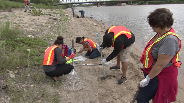 Volunteers with Drag the Red searched along the banks of the Red River near the Disraeli Bridge in one of their regular searches. (CBC)