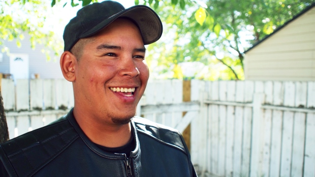 """I spent a few years living under the bridges."" Crazy Indians Brotherhood member Justin Bird used to live homeless in Saskatoon. (Josh Lynn/CBC)"