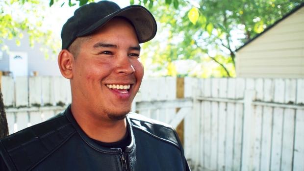 """I spent a few years living under the bridges."" Crazy Indians Brotherhood member Justin Bird used to live homeless in Saskatoon. (Josh Lynn/CBC)"