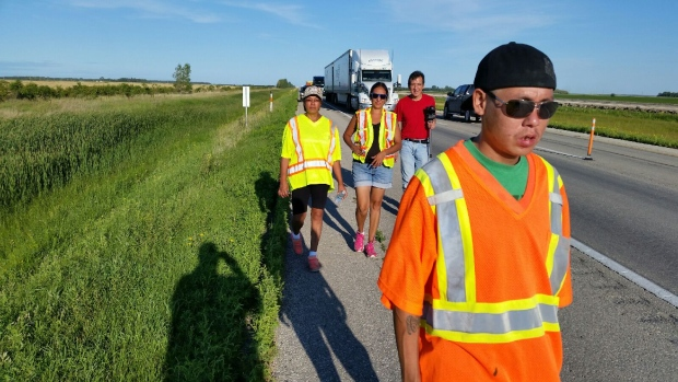 Members of Norway House First Nation are shown here on their cross-country walk in August. The group is trying to raise awareness for Canada's missing and murdered indigenous people and drum up support for a national inquiry. (Cliff Simpson/CBC)