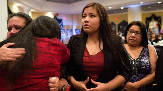 Rinelle Harper, centre, stands with the families of missing and murdered indigenous women during the Spirit of Our Sisters National Gathering 2015 in Edmonton, Alberta on Tuesday, September 29, 2015. (Amber Bracken for The Globe and Mail)