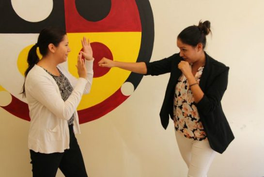 Martial arts expert Christina Keeper throws a punch towards Jarita Greyeyes during a martial arts demonstration on Wednesday.
