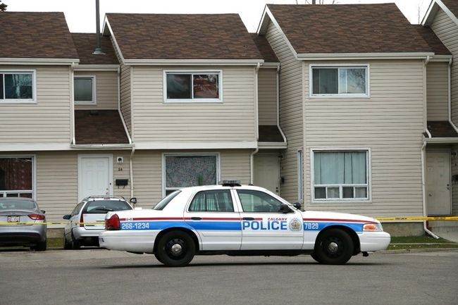 Calgary City Police hold the scene at a homicide on Ranchlands Bay NW in Calgary, Ab., on Monday October 12, 2015. Mike Drew/Calgary Sun/Postmedia Network Mike Drew/Calgary Sun
