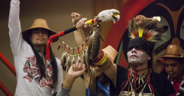 "SEATTLE, WA - OCTOBER 13: Nikk ""Red Weezil"" Dakota (R), from the Turtle Mountain Band of Chippewa, celebrates with others from various tribes during Indigenous Peoples' Day events at the Daybreak Star Cultural Center on October 13, 2014 in Seattle, Washington. Earlier that afternoon, Seattle Mayor Ed Murray signed a resolution designating the second Monday in October to be Indigenous Peoples' Day. (Photo by David Ryder/Getty Images)"