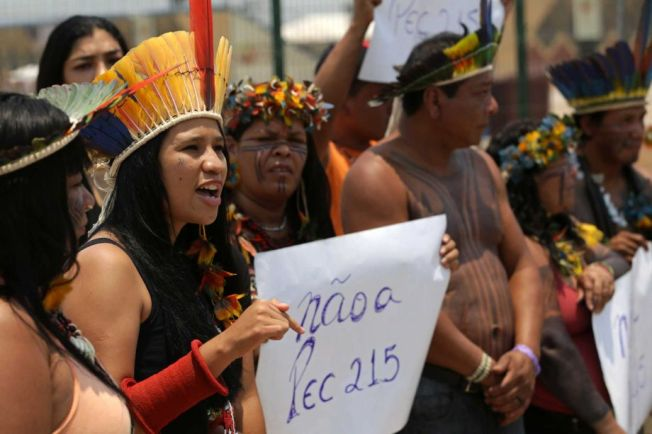 Karaja indigenous woman Narube Werreria protests the World Indigenous Games outside the arena in Palmas, Brazil, Thursday, Oct. 22, 2015.