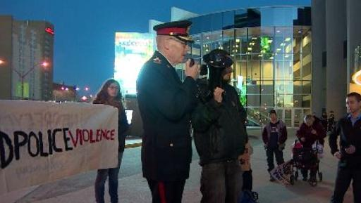 Police Chief Clive Weighill speaks at rally.