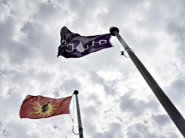 The Mohawk and Five Nations flags fly outside the former site of a Canadian border post in the middle of Akwesasne Mohawk reserve, photographed Wednesday, July 28, 2010. AARON LYNETT / (AARON LYNETT / NATIONAL POST)