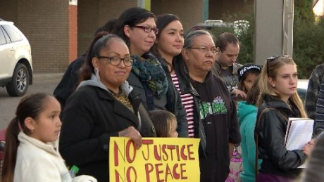 Several demonstrators showed their opposition to the police practice of carding at a rally in Saskatoon, held outside the location of a public meeting on policing. (CBC)