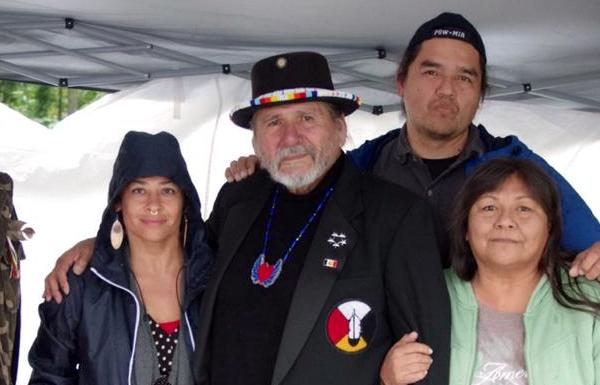 Dennis Banks, seen here with family friend Tracy Rector (left), Robert Upham, and an unidentified relative, stopped by the memorial gathering for Misty Upham.