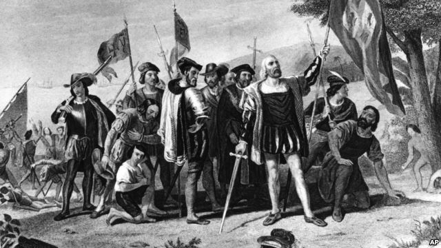 Historic painting of Christopher Columbus. He and his sailors stand in triumph at least on San Salvador, the Bahamas, on Oct. 12, 1492.