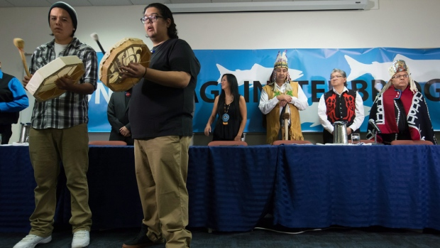 Drummers play as First Nations chiefs and leaders are welcomed at the start of a news conference about the Enbridge Northern Gateway pipeline in Vancouver, B.C., on October 1, 2015. (Darryl Dyck / THE CANADIAN PRESS)