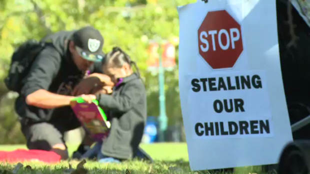 Dozens marched through Winnipeg and rallied for children in the care of Manitoba's Child and Family Services.